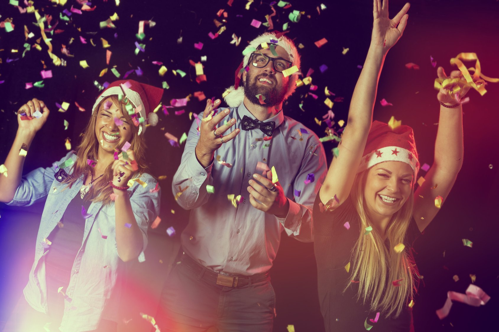 Group of young people dancing and having fun at a New Year's Eve Party