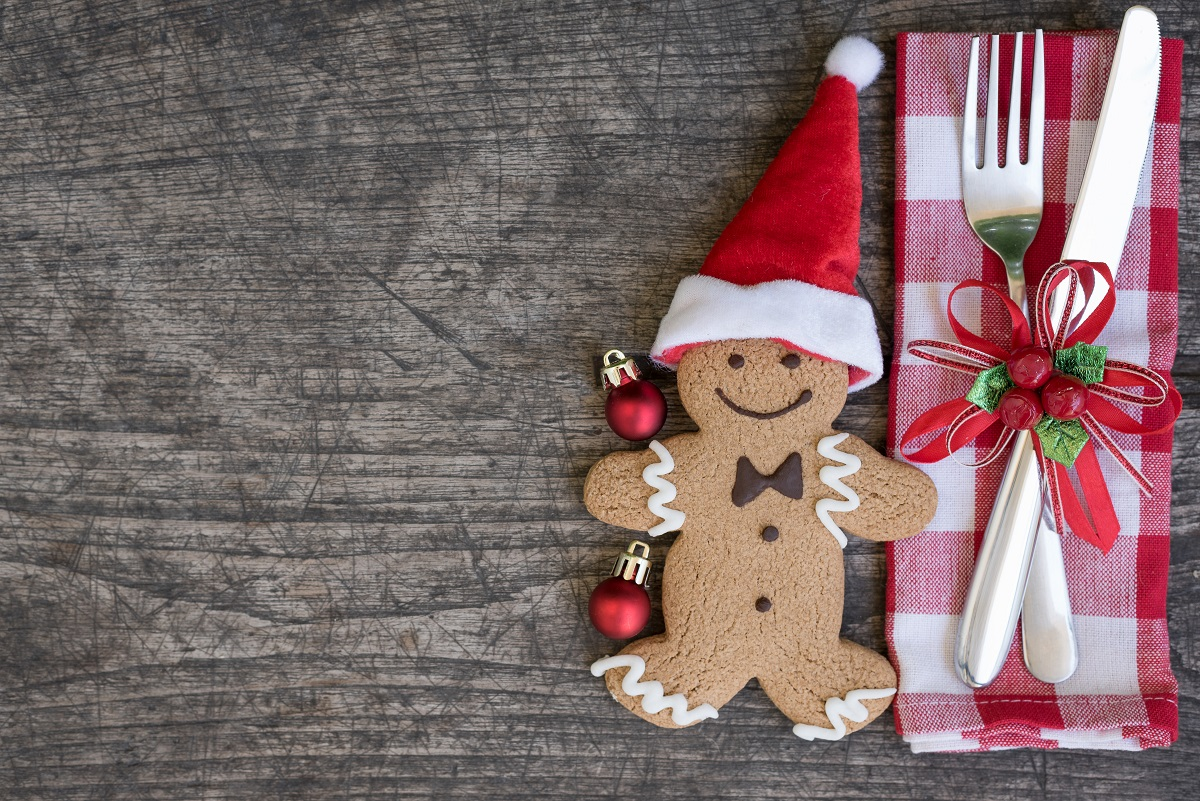 Christmas table place setting with santa claus gingerbread man cookie, Holidays background